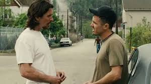 Russell (Christian Bale) shows some brotherly love to Rodney (Casey Affleck)